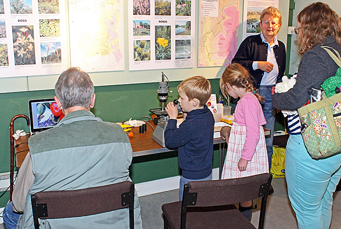 Young visitors with Barry Wendon's display