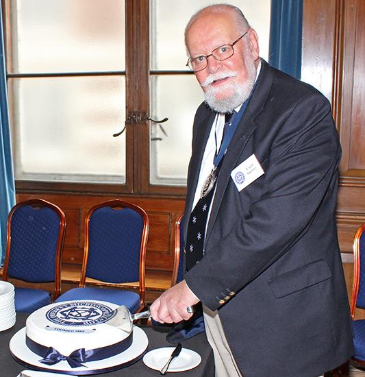 Carel Sartory cutting the cake