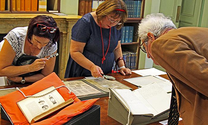 Visitors examining the exhibits