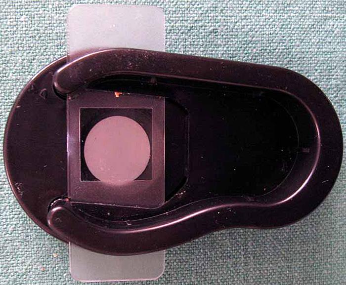 Plastic slide in the microscope base