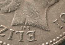 Designer's initials on £1 coin