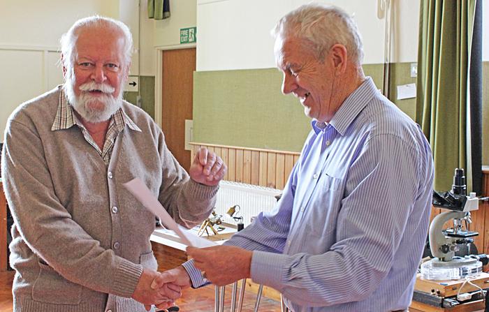 Carel Sartory presenting a certificate to Klaus Kemp