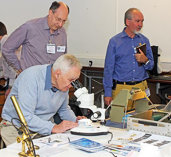 Chris Thomas watching Mark Shephard observing fruit flies
