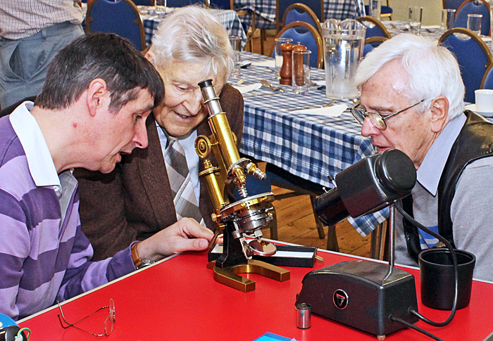 Dave Skeet explaining his Reichert microscope to Les Larkman