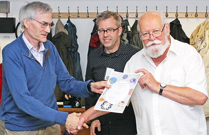John Rhodes receiving certificate from Carel Sartory