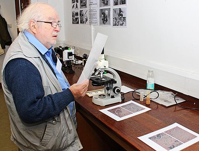 Malcolm Stewart with John Rhodes' exhibit
