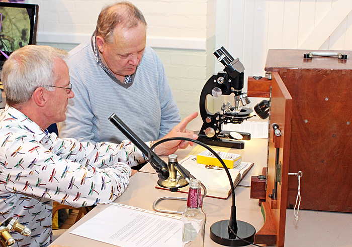 Tim Newton showing his microscopes to Peter Sunderland