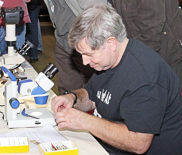 Robert Ratford examining Tim Newton's slides