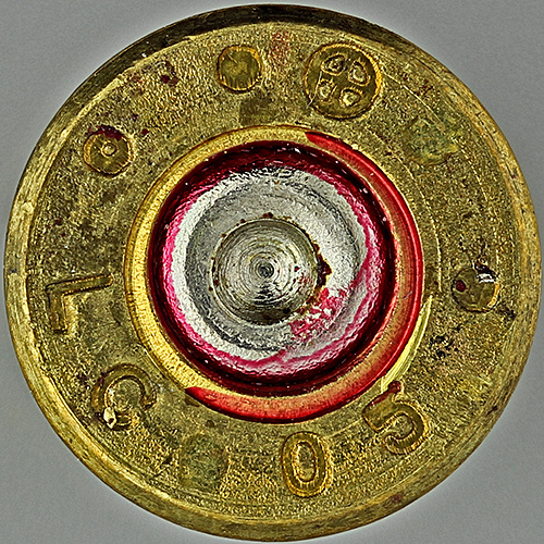 Pattern left by firing pin on a spent .223 cartridge case
