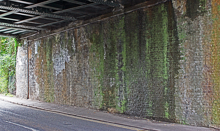 Wall under a railway bridge