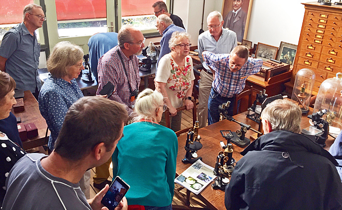 Members with old microscopes