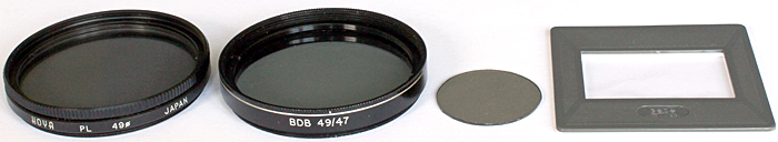 Glass polarising filter, polarising film in filter mount, polarising film analyser, Cellophane retarder in slide mount