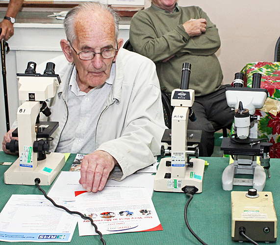 John Cox trying out a Swift microscope
