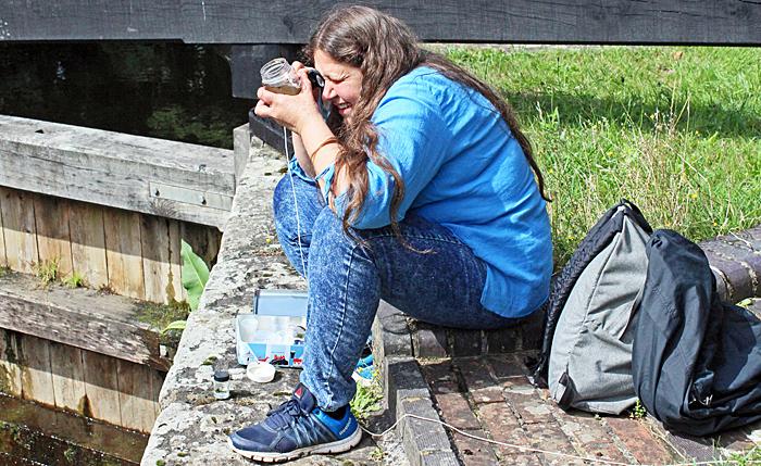 Irma Irsara examining her catch