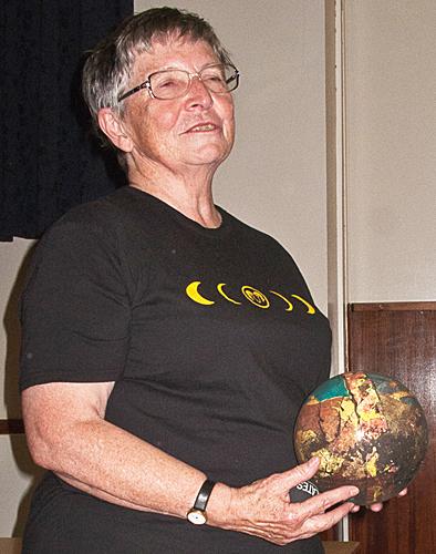 Joan Bingley with a globe