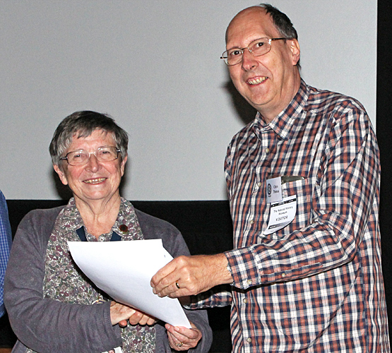 Chris Thomas receiving his certificate
