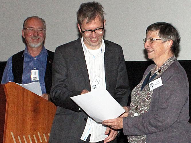 Wim van Egmond receiving his certificate