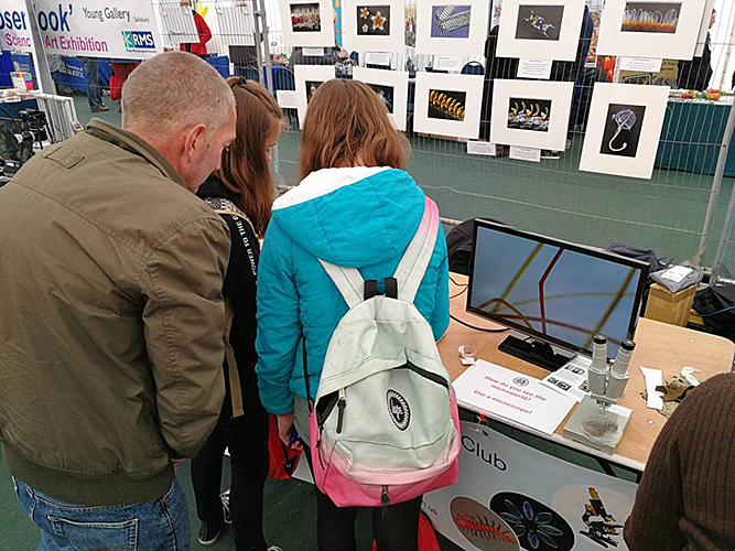 Visitors to the Quekett Microscopical Club stand