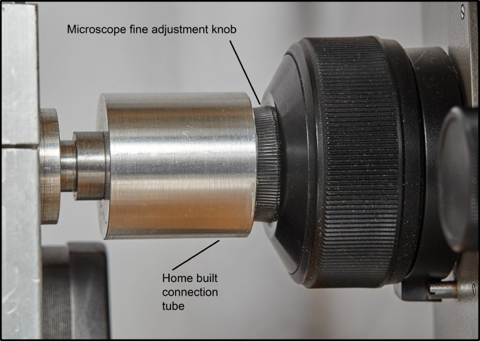 Spindle connection to microscope fine control knob
