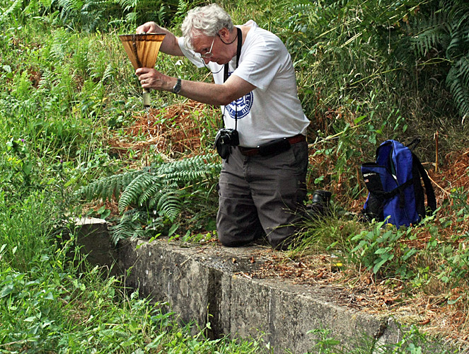 Graham Matthews collecting from the culvert