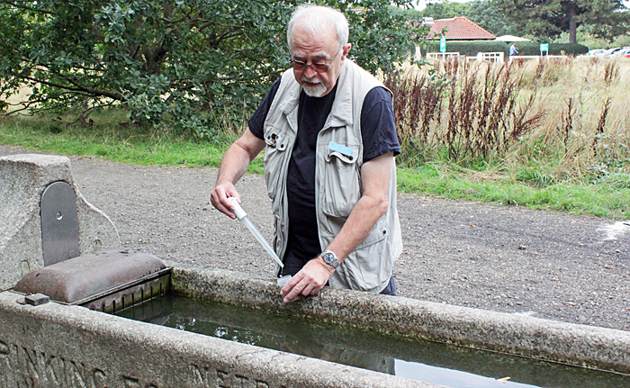 Paul Smith collecting from cattle trough