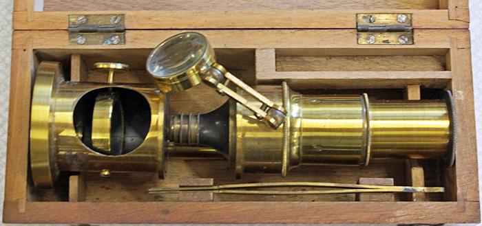 Small brass microscope