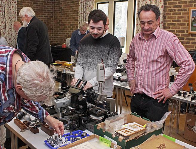 Graham Matthews examining items from Robert Cowen and his son