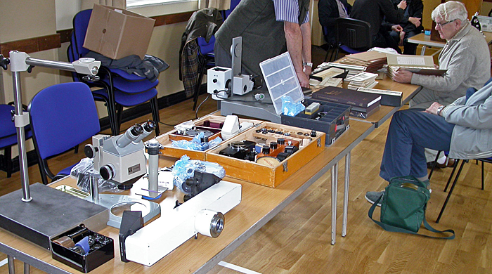 John Judson's sales table and Geoff Mould choosing slides