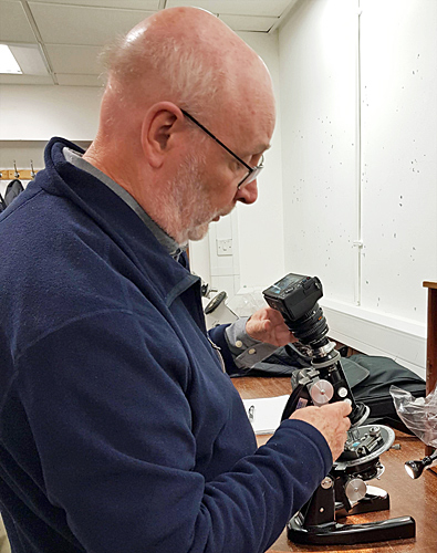 David Linstead with a Swift polarising microscope