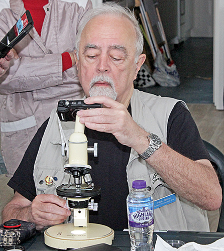 Paul Smith photographing specimens