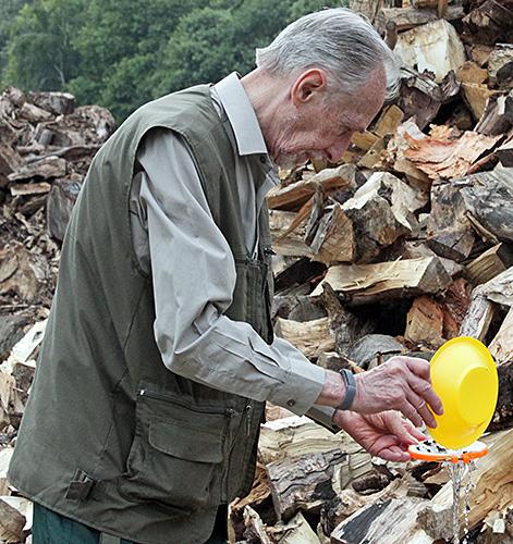 Dennis Fullwood emptying yellow pan trap