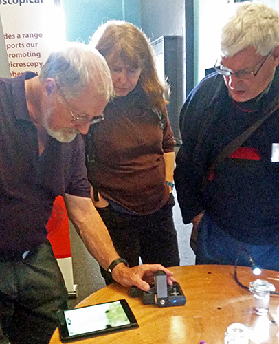Tony Pattinson and visitors with the ioLight microscope