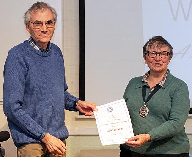John Rhodes receiving his Eric Marson certificate from Joan Bingley
