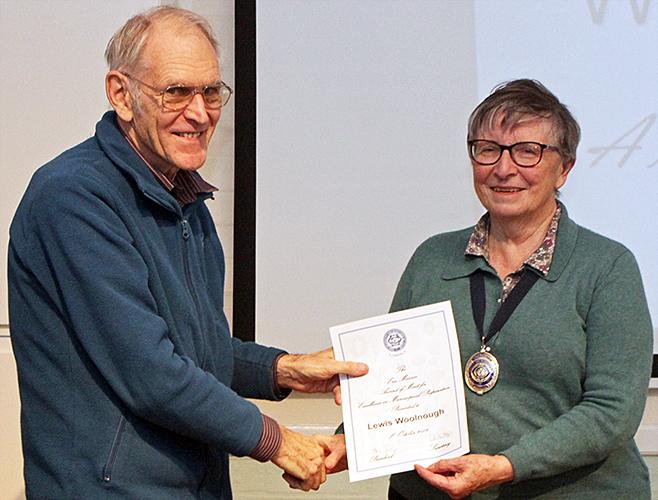 Lewis Woolnough receiving his Eric Marson certificate from Joan Bingley