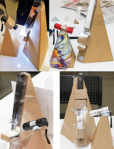 Four cardboard microscopes