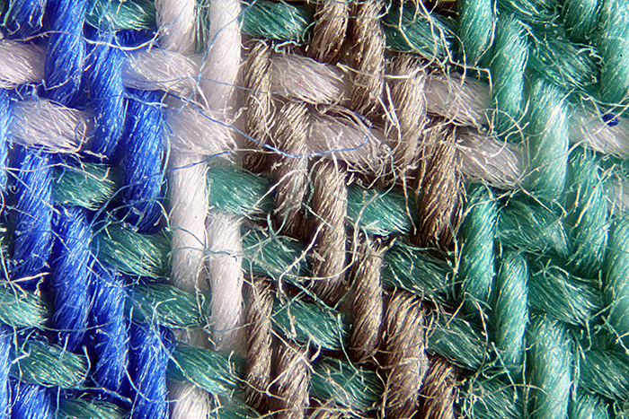 Photomicrograph of green tartan fabric