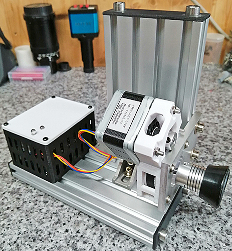 Arduinos (in box), stepper motor and rubber coupler