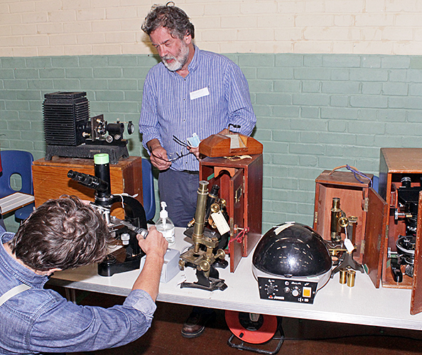 Brian Norman with some of his microscopes