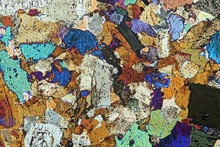Quartz diorite, crossed polarisers plus makeshift retarder
