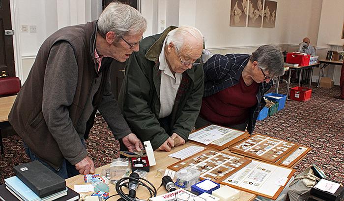 John Ward, John Charlton and Joan Bingley choosing slides