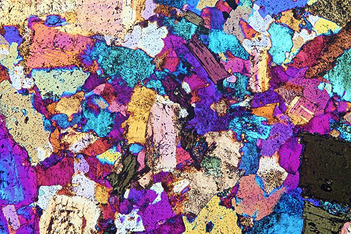 Quartz diorite, crossed polarisers plus full-wave retarder